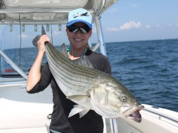 Tarin Keith with a big Striped Bass caught on a live bunker
